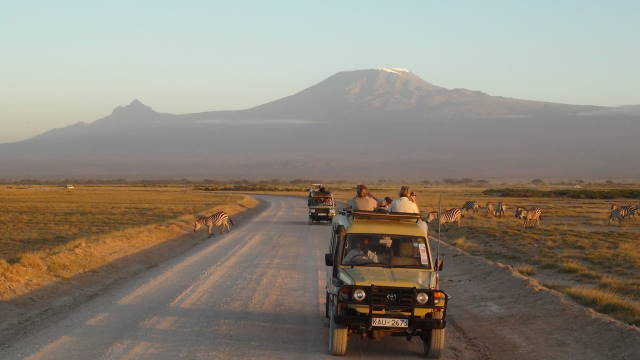 On safari in Amboseli National Park with Mount Kilimanjaro in the background.