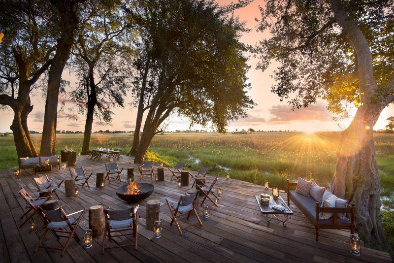 Sunset drinks on the deck overlooking the lagoon in the Okavango Delta.
